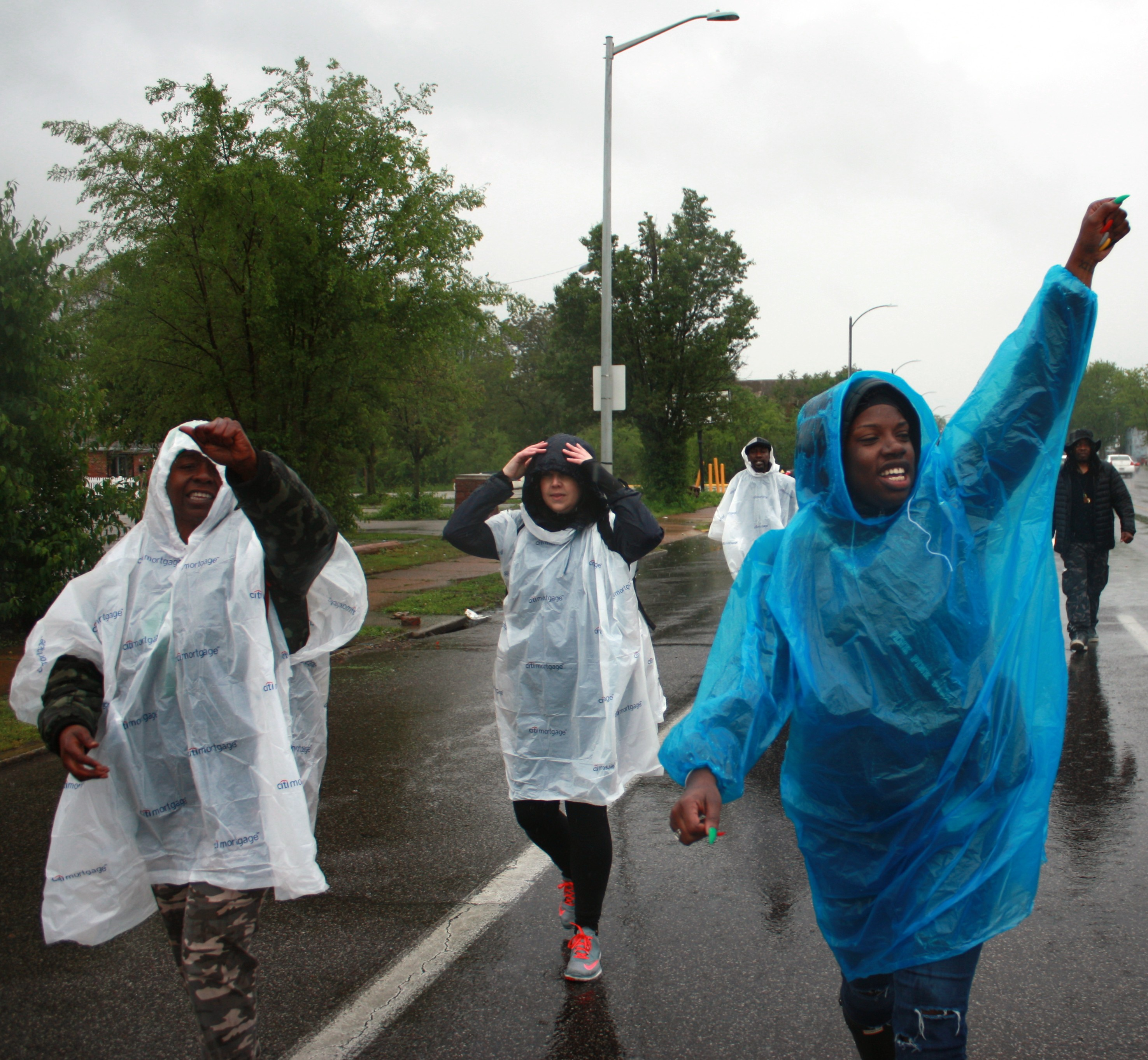 Recovered shooting victim leads march against gun violence