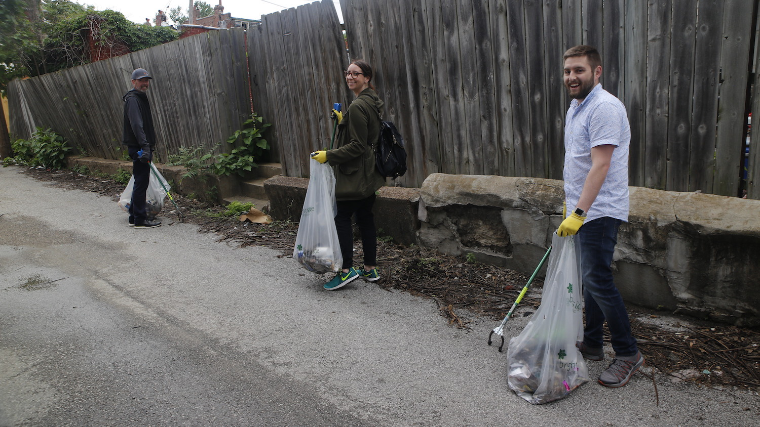 Neighbors band together for event that combines street clean-up, networking and beer