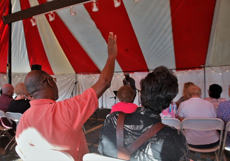 Tent meeting focuses on healing wounds of Ferguson