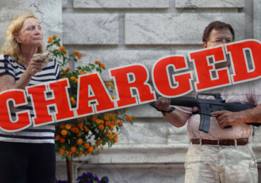 Gardner charges couple who pulled guns on protesters