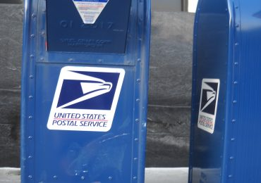 Mail-in ballots can't be returned in person, court rules