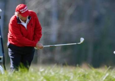 Trump golfs in Florida as COVID relief hangs in balance