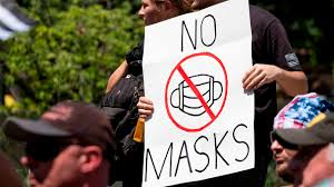 Tensions rise over masks as virus grips smaller cities
